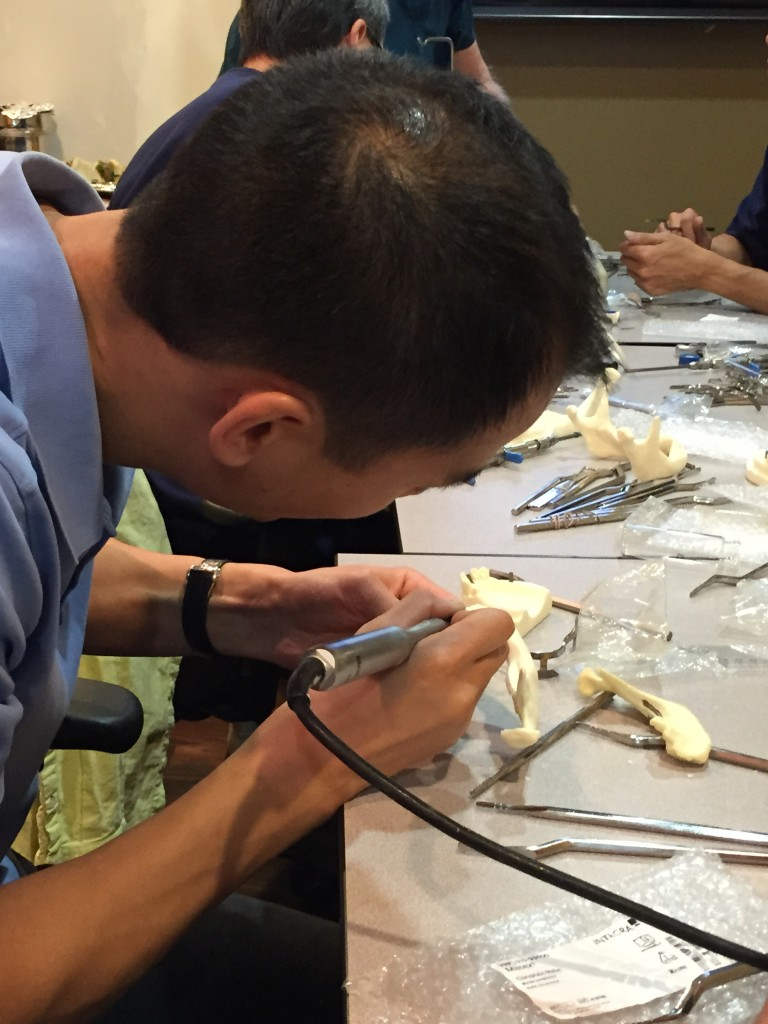 Dr. Tsang polishing his oral implantology skills